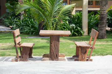 Empty wooden table and chairs of a beach garden near the sea