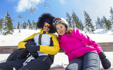 Mother and daughter on the ski vacation