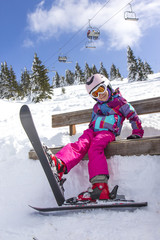Girl with ski on the mountain