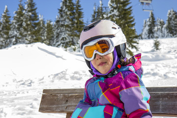Girl with ski goggles and helmet