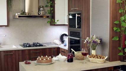 Woman making cake at modern kitchen