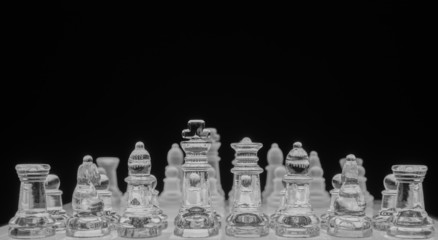 Glass chess game, black and white, shallow depth of field