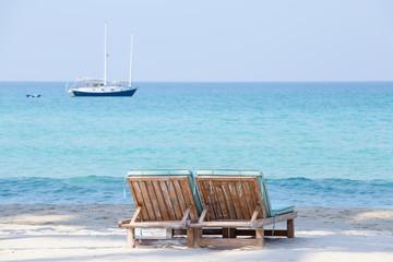 Two beach chairs and beautiful sand beach