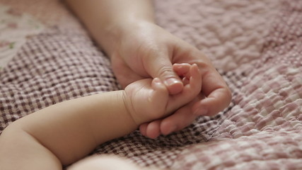 the child's mother a hand to hold when baby is sleeping