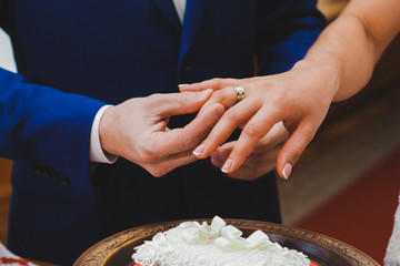 Groom wearing the Diamond ring to bride hand in wedding ceremony