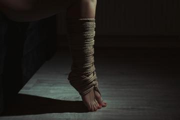 Tied legs.
