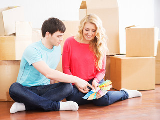Young couple moving into a new home and choosing the right color