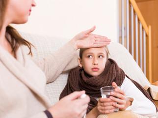 Woman measures temperature of daughter