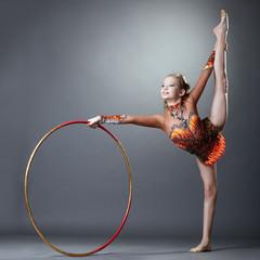 Adorable rhythmic gymnast doing vertical split