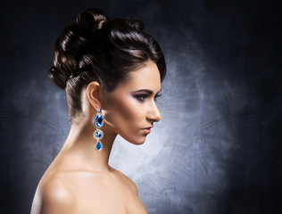 Young, beautiful and rich woman in jewels and makeup