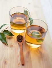 tea and tea leaves on wooden table