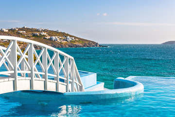 Wooden footbridge over luxury swimming pool