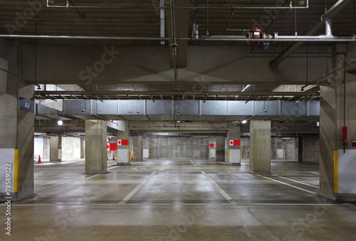 Parking garage underground interior, neon lights in dark - 78569022
