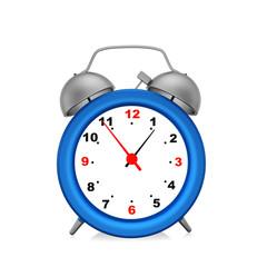 Blue  alarm clock on  white background.