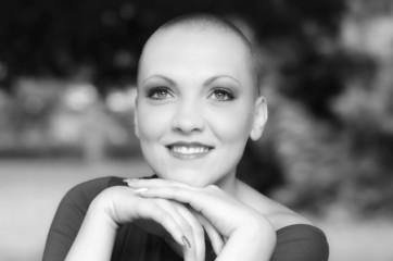 Beautiful young bald woman - cancer survivor