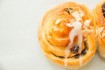 Raisin cream roll danish and almond slice.