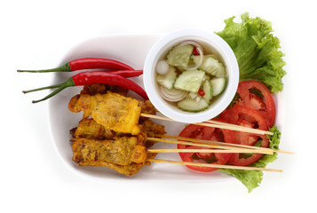 Grilled pork satay with sauce on plate Thai Food