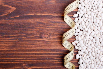 raw white beans on the board dietetic food
