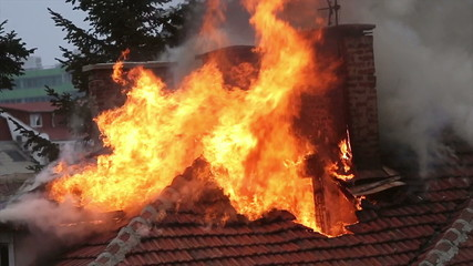 Firefighters burning house