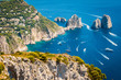 Capri, Faraglioni in the mediterranean sea. Italy, Naples - 78573015