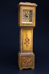 retro alarm clock tower shaped on black background