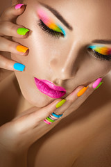 Sexy girl portrait with vivid makeup and colorful nailpolish