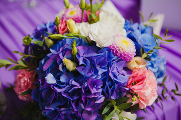 Beautiful flowers on table in wedding day. Violet flowers.