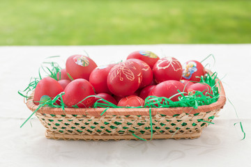 Red eggs in basket as decoration for Easter