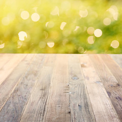 Spring rustic background with green bokeh
