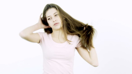 Girl with long hair annoyed by volume and split ends