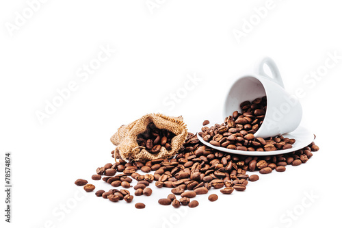 white cup with coffee beans isolated - 78574874