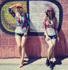 Two teen girl friends together having fun. Outdoors, urban lifes