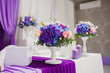 Beautiful flowers and candles on table in wedding day. Violet