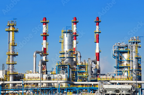 Petrochemical plant over blue sky. - 78578286