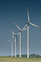 Wind turbine farm on rural terrain