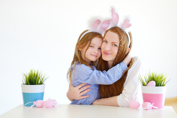 Mother and daughter wearing bunny ears on Easter