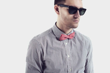 Young man hipster  with bow tie sunglasses confident certained