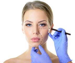 Beautiful woman ready for cosmetic surgery, female face with doc