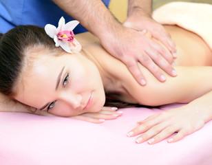 Beautiful woman enjoy having relaxing massage her back in spa sa