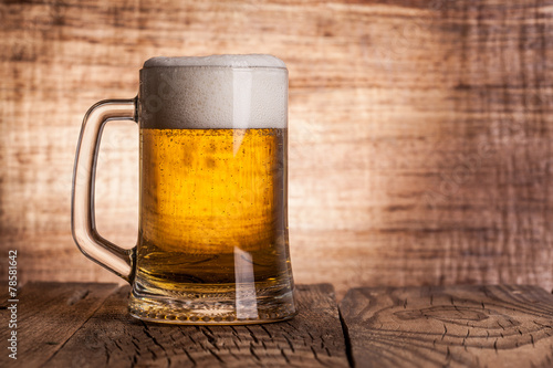 canvas print picture Glass beer on wood background