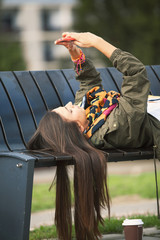 Young woman using mobile phone in park