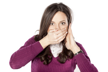 shocked young woman covering her mouth with hand