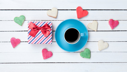 Cup of coffee and cookies with gift box