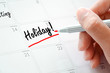Holiday text on the calendar (or desk planner)  - 78582898