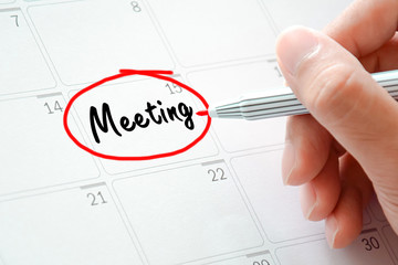 Meeting text on the calendar (or desk planner)