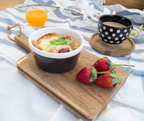 Set of breakfast with toasts , egg, sausage, coffee and fruits