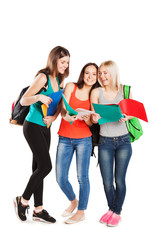 group of the college smiling students on a white background