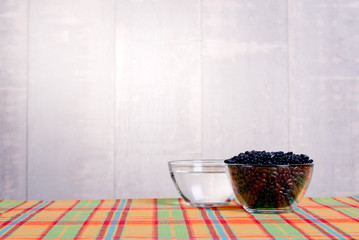 raw black beans on the board diet food