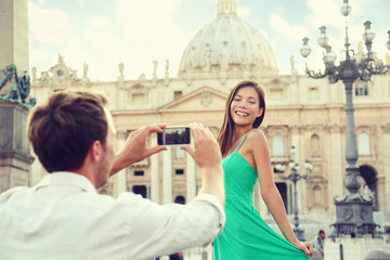 Couple taking smartphone picture at Vatican, Italy