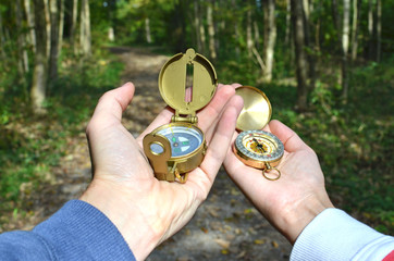 Man and woman holding compasses